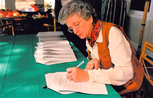 Patricia Shield Ayres signs a conservation easement agreement in 1998.